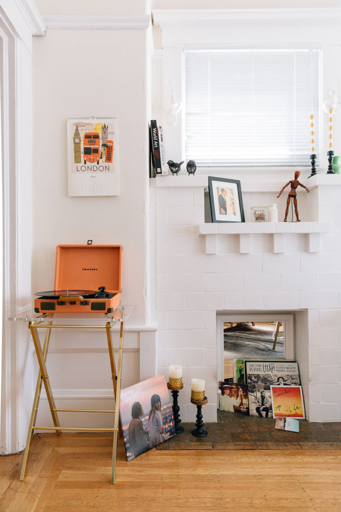 the-everygirl-julia-goodwin-home-tour-office-record-player-and-fireplace